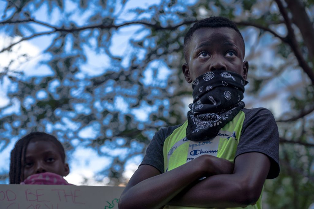 A young protester listens during a Justice for George Floyd demonstration on June 11, 2020, in Minneapolis.