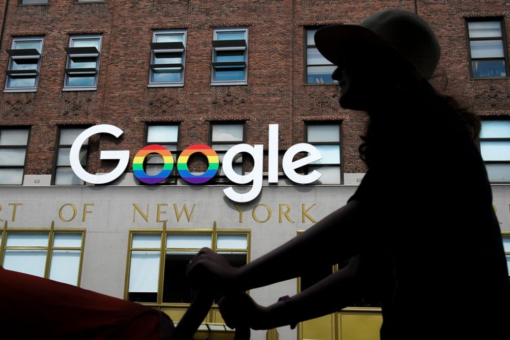 A woman walks past Google's New York City office in June 2019.
