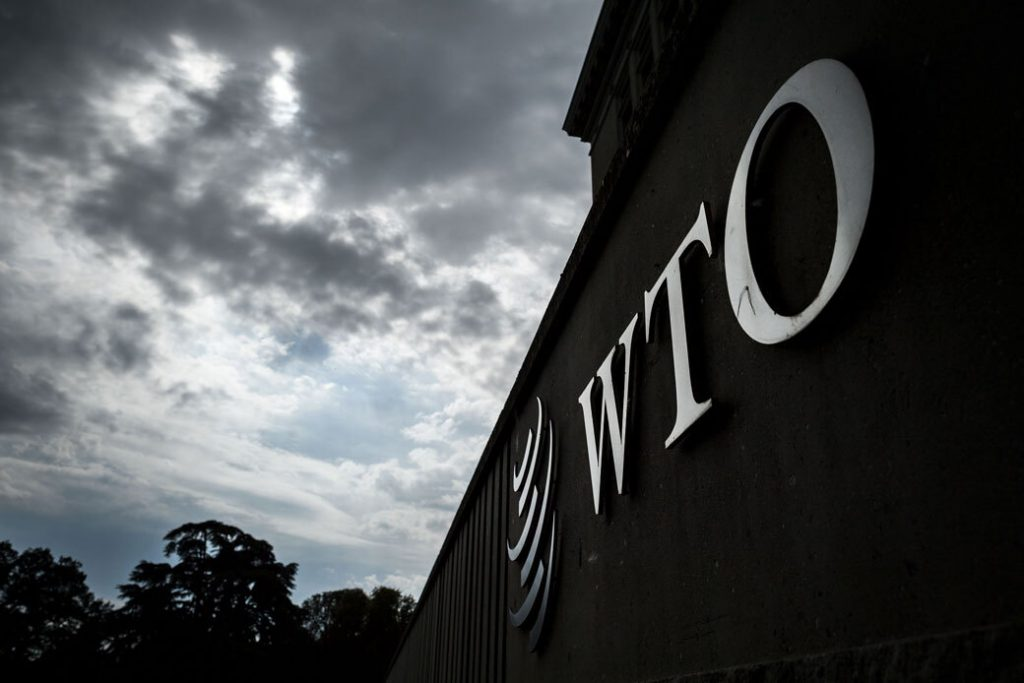 A sign of the World Trade Organization (WTO) is seen on their headquarters in Geneva, September 2018.