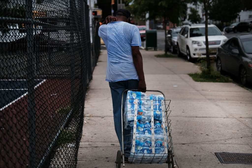 Residents of Newark, New Jersey, receive free water after lead was found in the tap water in August 2019.