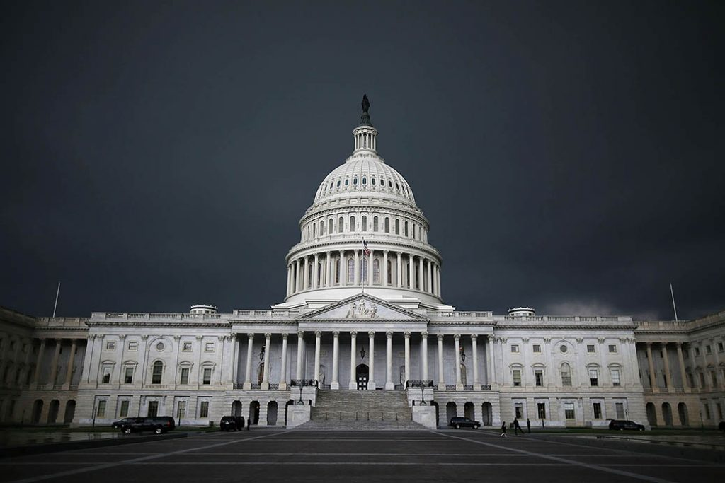 Storm clouds fill the sky over the U.S. Capitol Building, June 2013, in Washington, D.C.