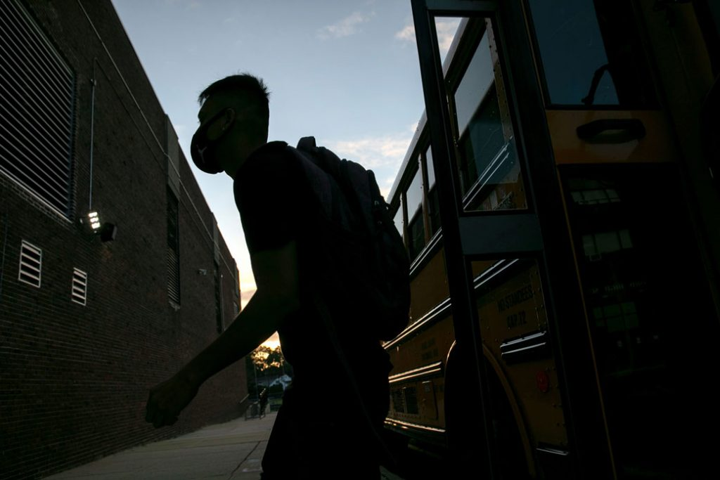 A student arrives to a high school in Stamford, Connecticut, September 2020.