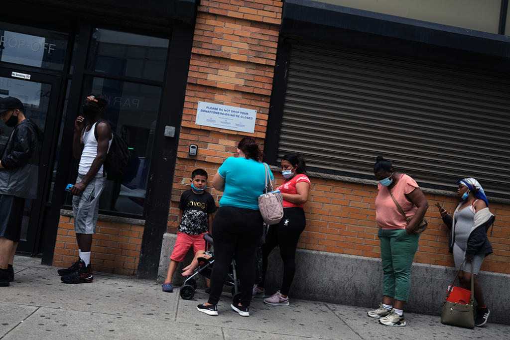 People wait in line for food assistance cards in Brooklyn, New York, July 2020.