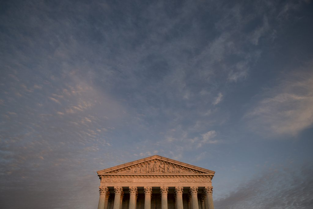 The U.S. Supreme Court building is seen at sunset in November 2019.