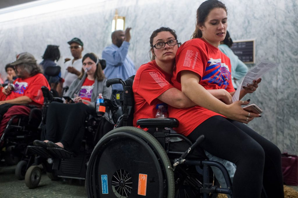 Sisters wait in line for a Senate Finance Committee hearing on the proposal to repeal and replace the Affordable Care Act, September 25, 2017.