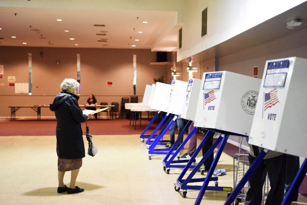 A voter walks to fill in her ballot at a polling station in New York, November 2018.