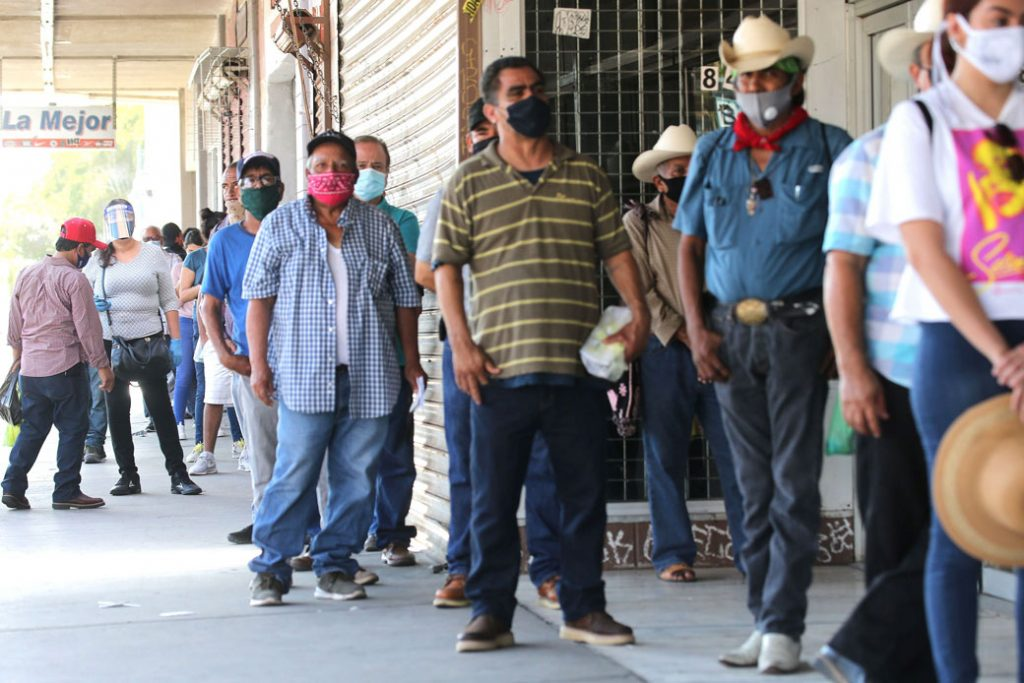 People wait in line to fill out unemployment forms near the U.S.-Mexico border in Calexico, California, which has been hard-hit by the COVID-19 pandemic, on July 24, 2020.