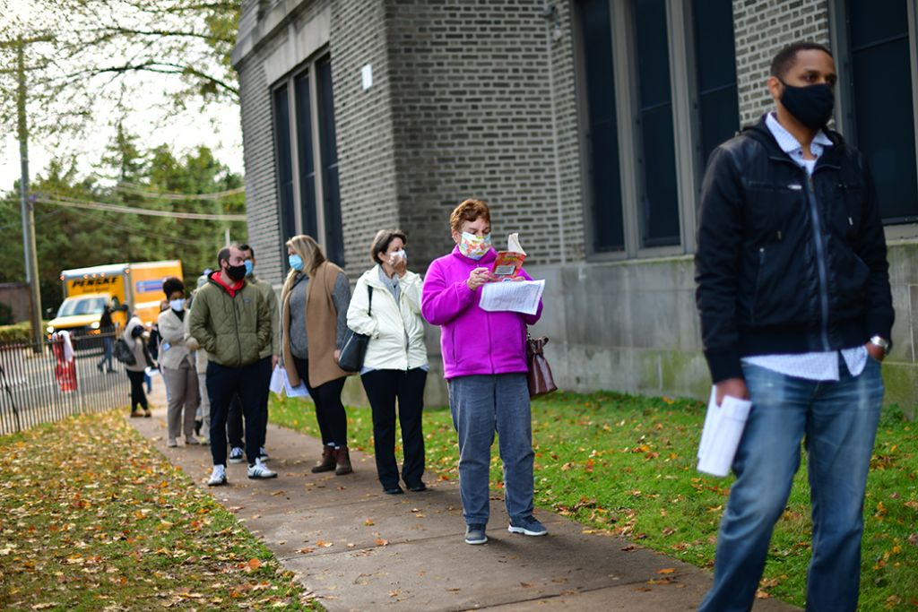 Voters stand in line outside of a satellite polling station in Philadelphia, October 2020.