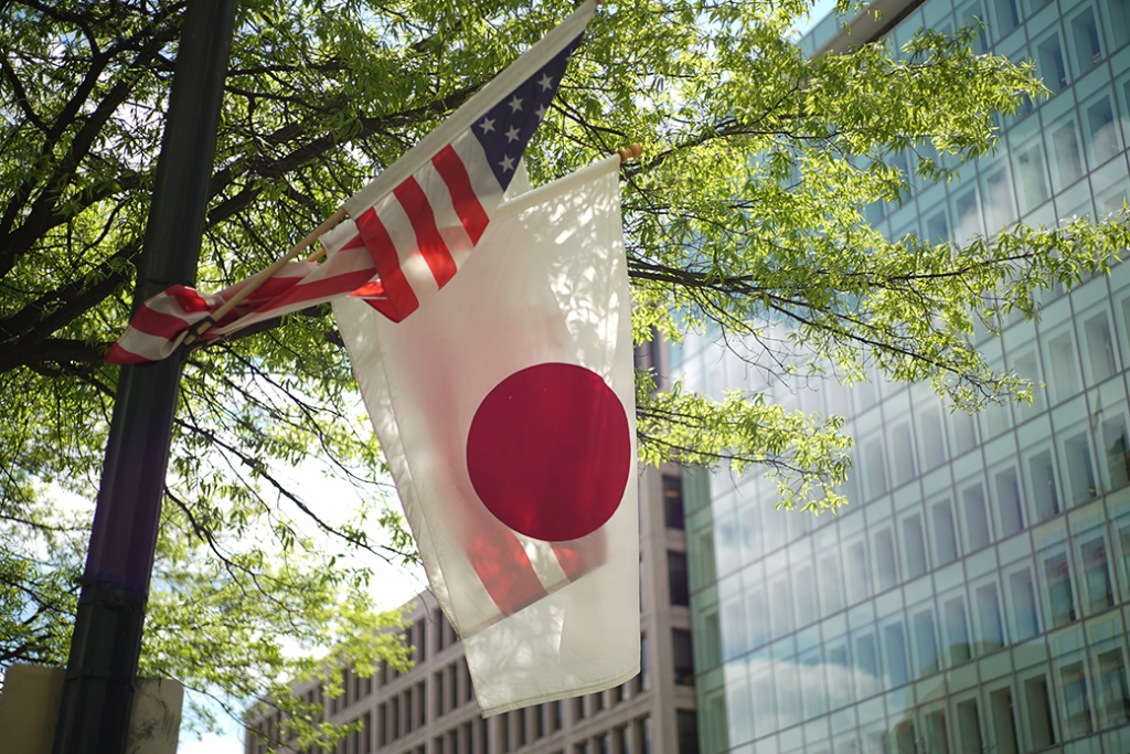 The U.S. and Japanese flags fly on a lamp post in Washington, D.C., the day before the White House hosts Japanese Prime Minister Shinzo Abe for a visit, April 2015.