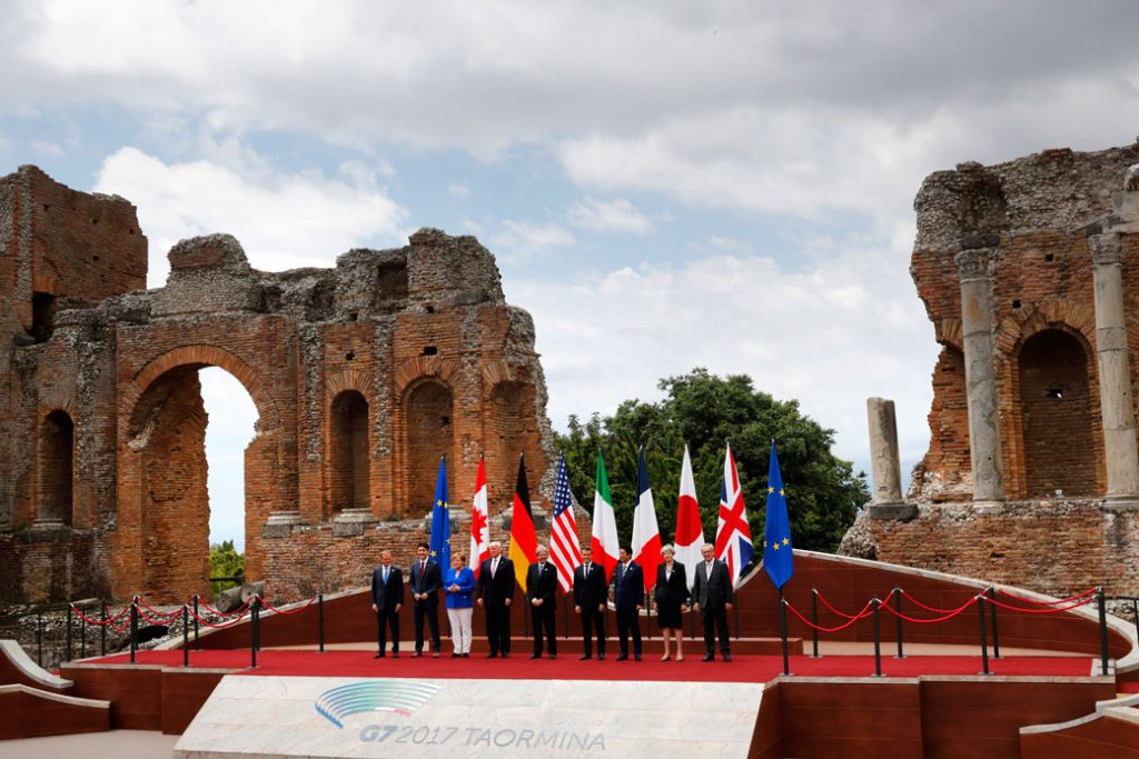 World leaders pose for a photo at the Ancient Greek Theater of Taormina during the G-7 summit in Sicily on May 26, 2017.