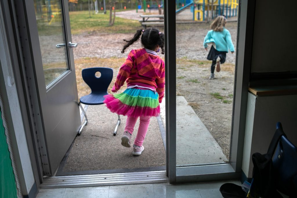 """Children race outside during a """"mask break"""" from class in Stamford, Connecticut, October 2020."""