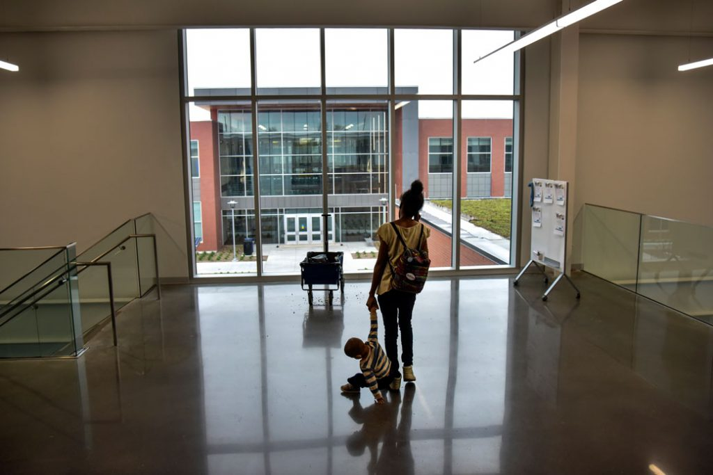 A woman and her son leave a classroom on the Fort Omaha Campus of Metropolitan Community College in Omaha, Nebraska, on May 1, 2018.