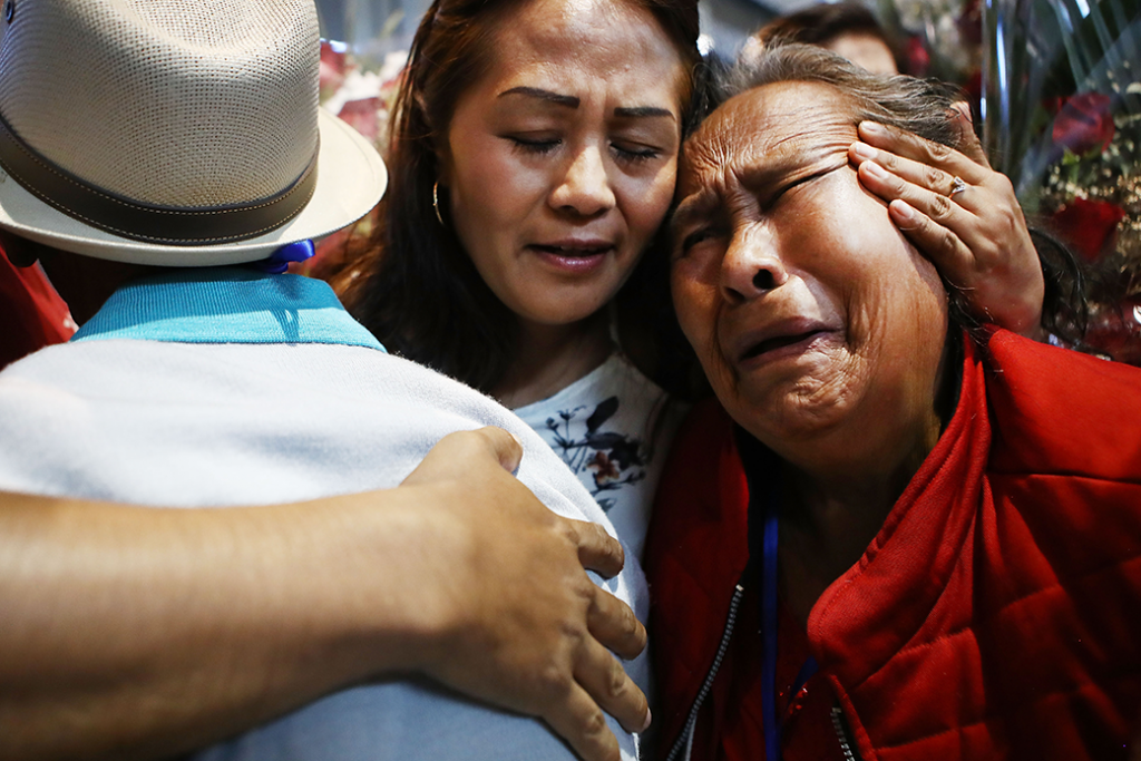 Family members hug at a reunification event for Mexican families who have been separated from their loved ones living in the United States, Los Angeles, September 2018.