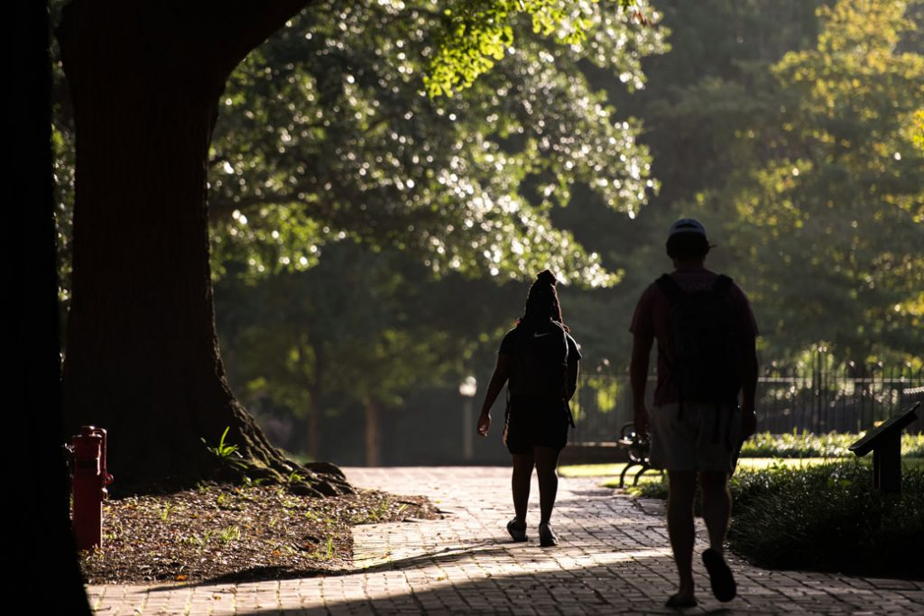 University students walk across their school's campus in Columbia, South Carolina, on September 3, 2020.