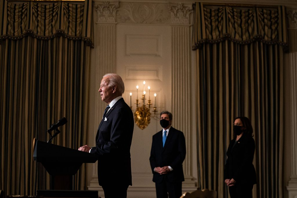 President Joe Biden speaks about climate change issues in the State Dining Room of the White House on January 27, 2021, in Washington. Biden signed several executive orders related to the climate change crisis that day. Also pictured, left to right, are Special Presidential Envoy for Climate John Kerry and Vice President Kamala Harris.