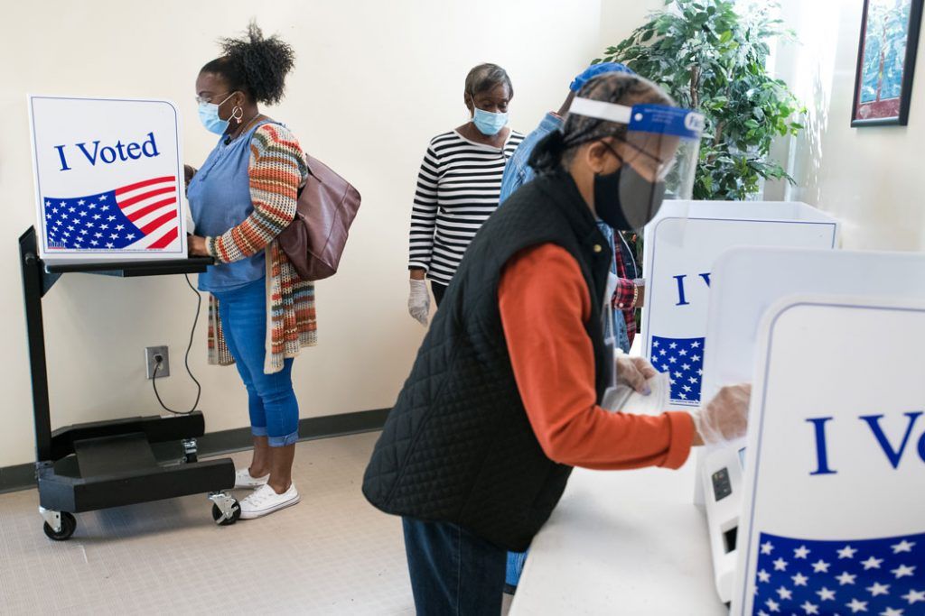 People cast votes on the second day of in-person absentee and early voting in Columbia, South Carolina, October 2020.