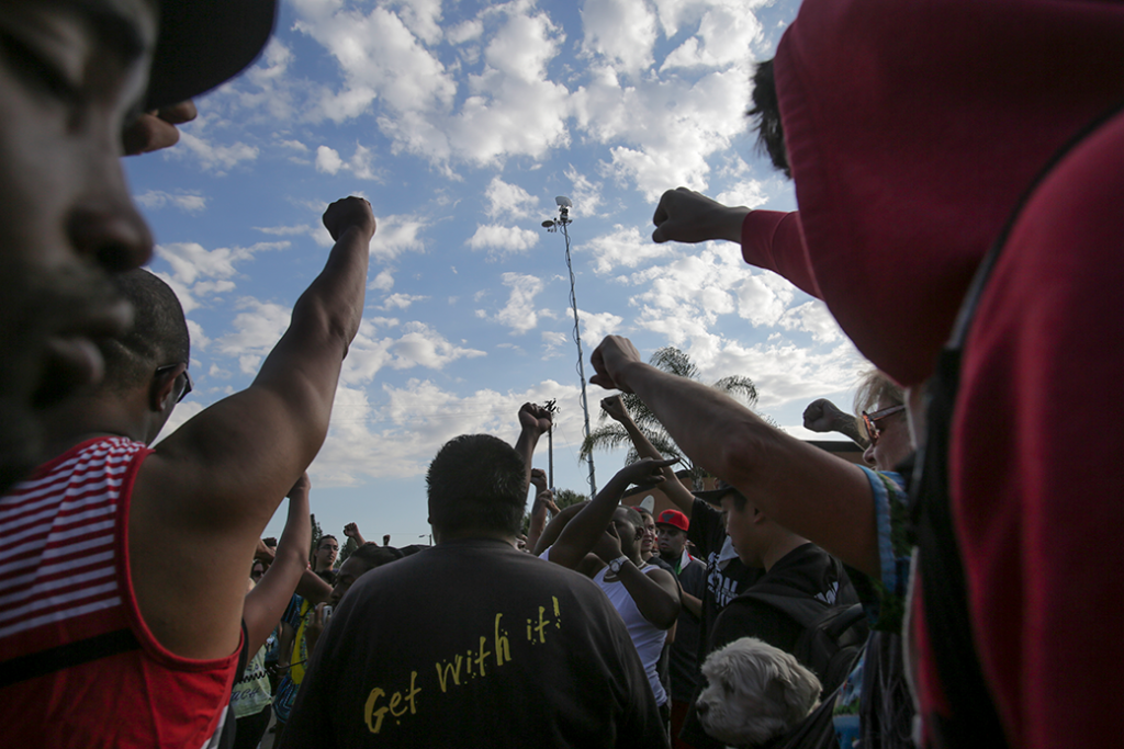Demonstrators raise their fists during a rally in San Diego following the fatal police shooting of an unarmed Black man, identified as Ugandan refugee Alfred Olango, who was said to be mentally ill, September 2016.