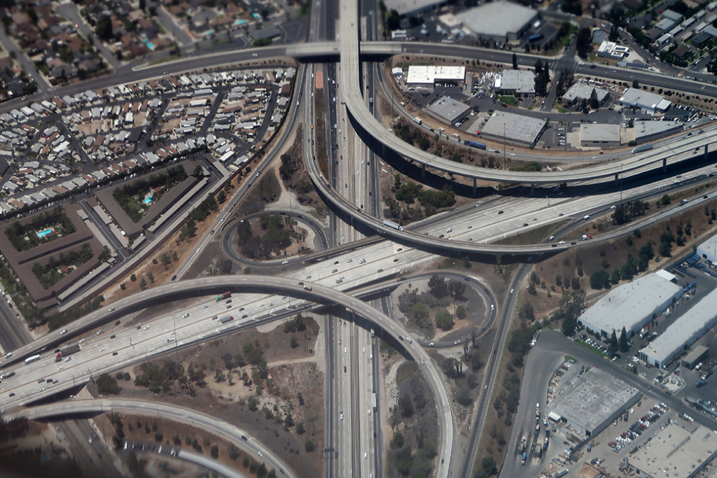 A highway interchange is seen through the exhaust of an airplane in Costa Mesa, California, June 2018.
