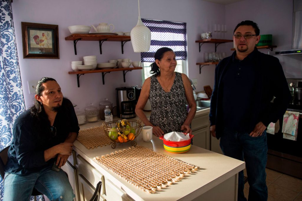 A Salvadoran immigrant affected by the U.S. government's end of TPS in January 2018 rests with his family at their kitchen in Laurel, Maryland, in January 2018.