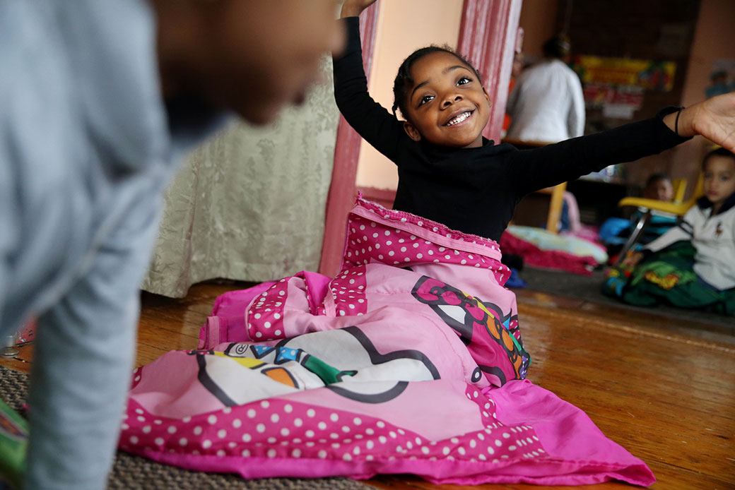 A 4-year-old wakes from naptime at the preschool program at Paige Academy in Boston on January 27, 2017.