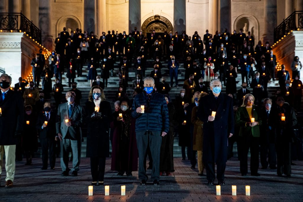 Members of Congress observe a moment of silence in memory of the 500,000 deaths due to COVID-19 on the steps of the U.S. Capitol in Washington, D.C., on February 23, 2021.