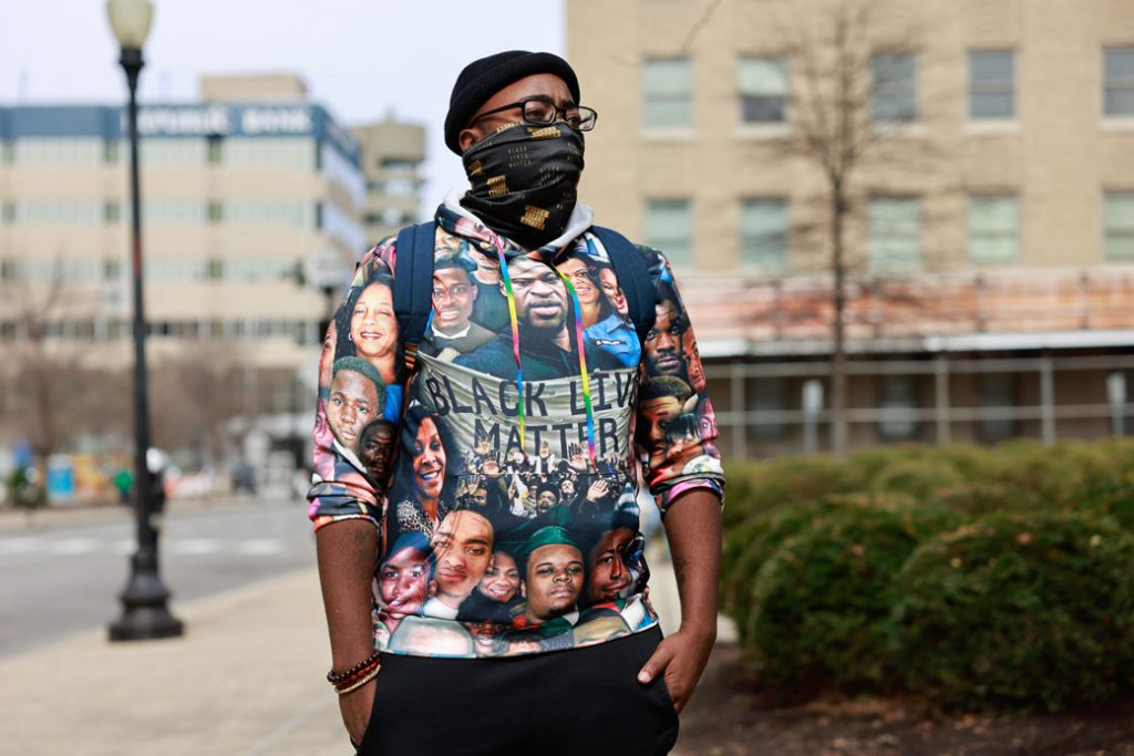 A protester wearing a Black Lives Matter T-shirt stands at a memorial event in Jefferson Square Park in Louisville, Kentucky, on March 13, 2021, to mark the one-year anniversary of Breonna Taylor's death.