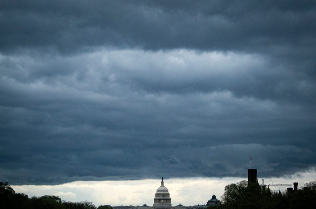 Clouds form above the U.S. Capitol in between rain showers on the National Mall, March 2021.