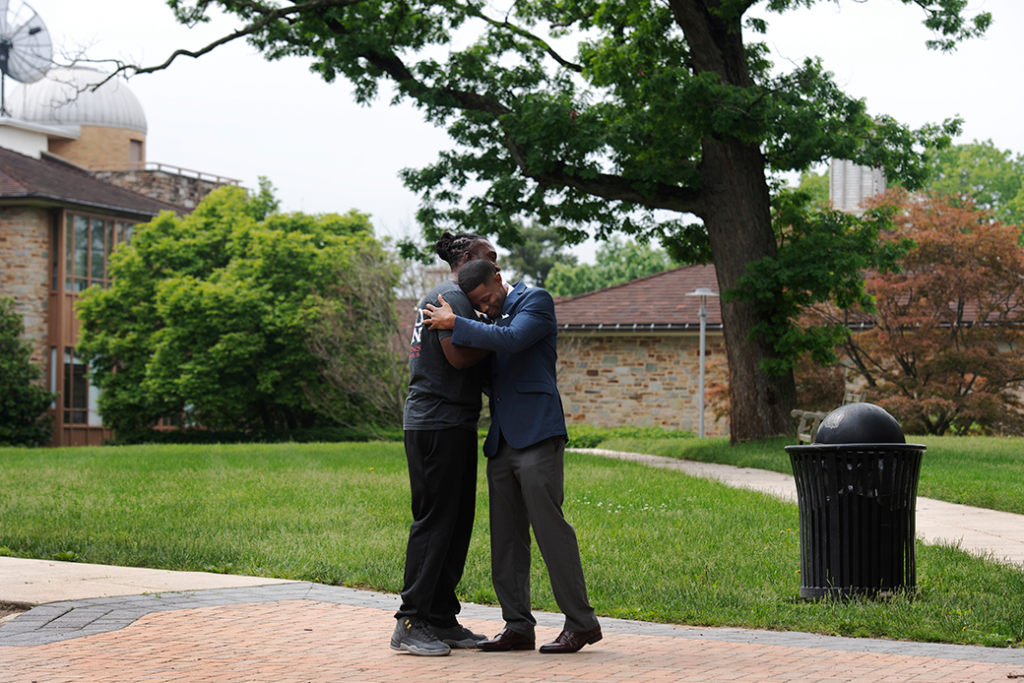 Donte Small embraces his former cellmate Sanford Barber in Towson, Maryland, May 2018. Both men participated in the Goucher Prison Education Partnership, which provides men and women incarcerated in Maryland with the opportunity to pursue a college education.