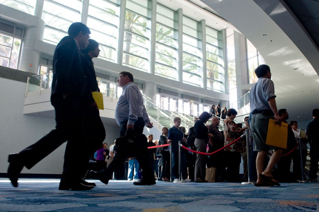 Job seekers line up to enter a job fair at the Anaheim Convention Center in Anaheim, California, on June 19, 2013.