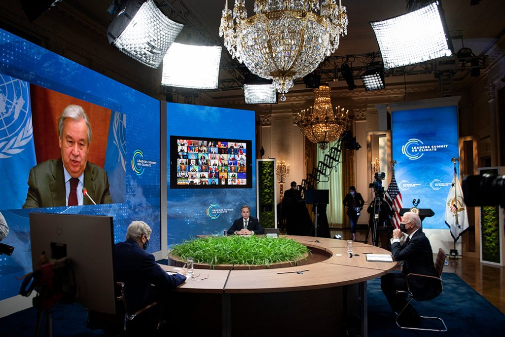 From left to right: Special Presidential Envoy for Climate John Kerry, Secretary of State Antony Blinken, and President Joe Biden listen as U.N. Secretary-General António Guterres speaks onscreen during a climate change virtual summit from the East Room of the White House campus, April 22, 2021, in Washington.