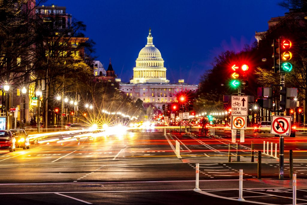 Cars with streaked headlights are seen on Pennsylvania Avenue going toward the U.S. Capitol during afternoon rush hour in Washington, D.C.