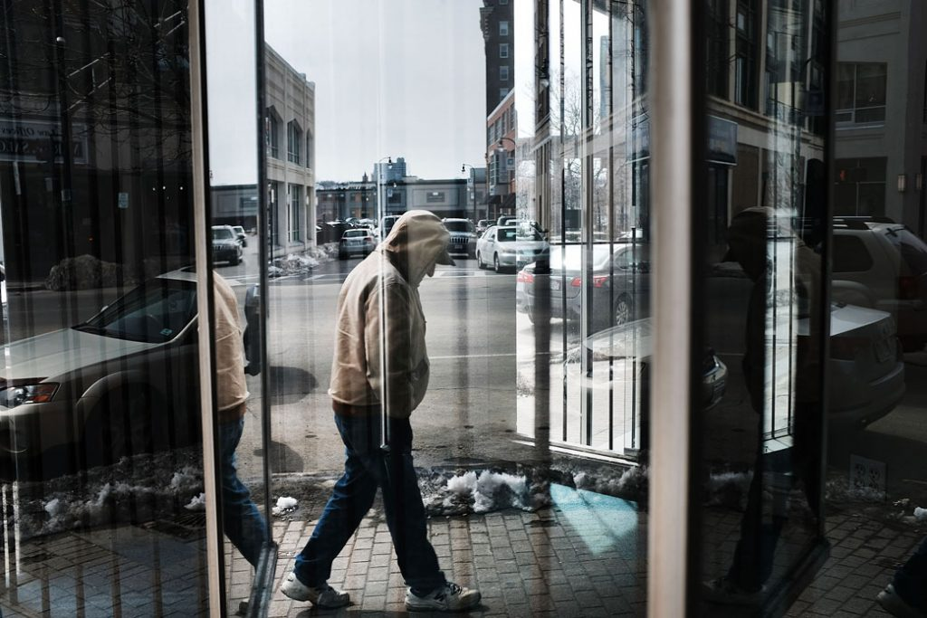 A man walks through an economically distressed section of Worcester, Massachusetts, on March 20, 2018.