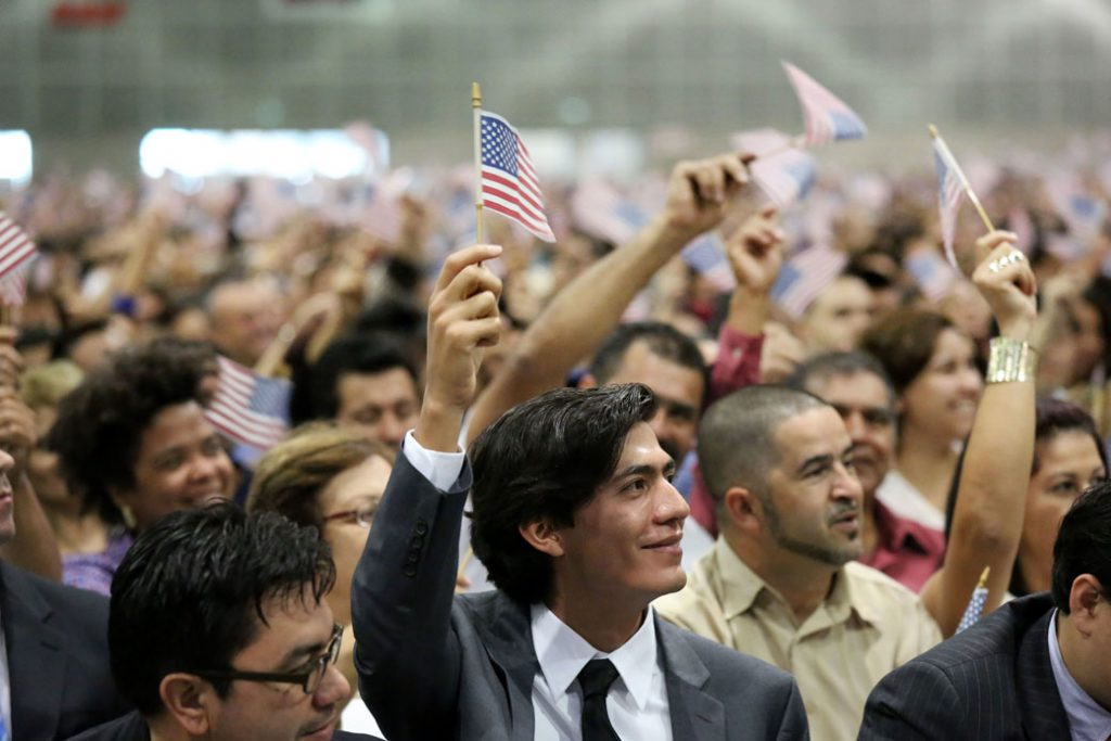 Immigrants become U.S. citizens during a naturalization ceremony in Los Angeles in November 2012.