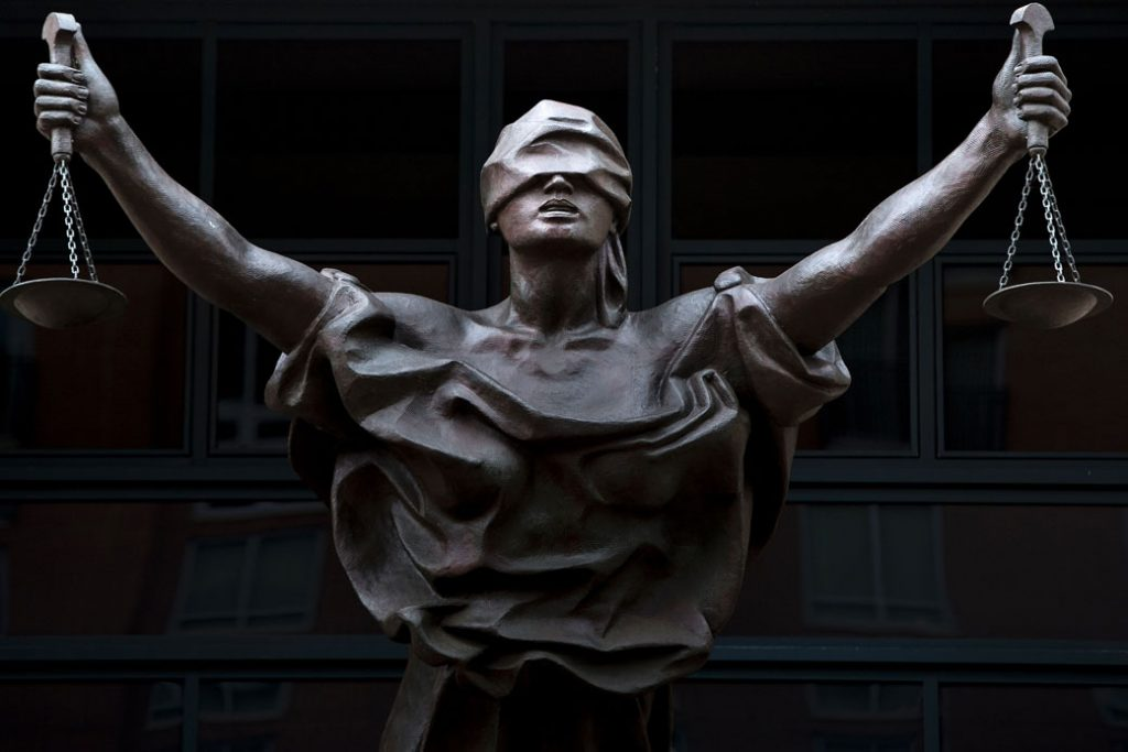 A a statue of blind justice is seen outside the Albert V. Bryan U.S. Courthouse in Alexandria, Virginia, September 2016.