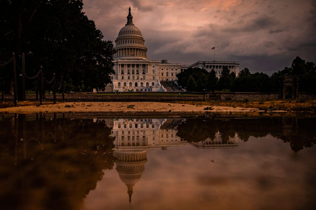 The U.S. Capitol Building is seen as the sun sets and a heavy thunderstorm forms over Washington, D.C., on July 26, 2021.