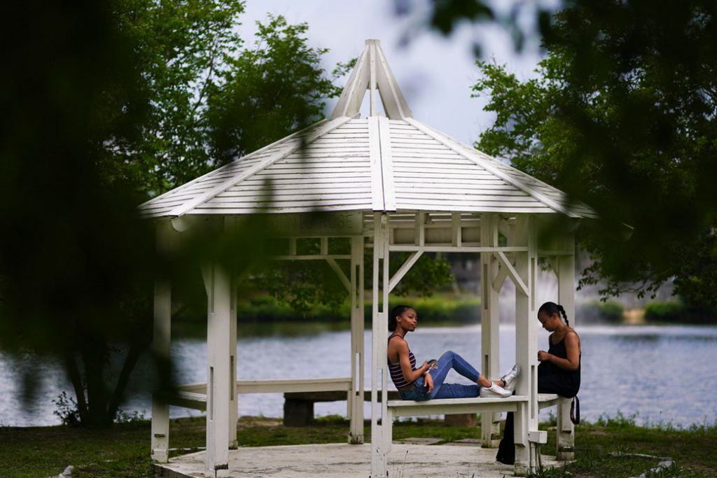 A mother and her daughter sit in Briscoe Park in Snellville, Georgia, June 2021.