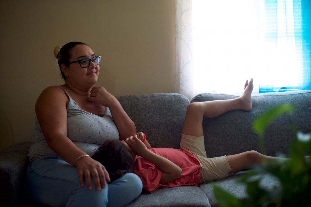 A mother sits with her daughter in their residence in Northeast Philadelphia on July 8, 2018.