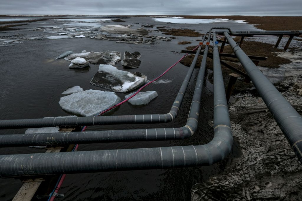 Pipelines extend across the landscape outside Nuiqsut, Alaska, May 2019.