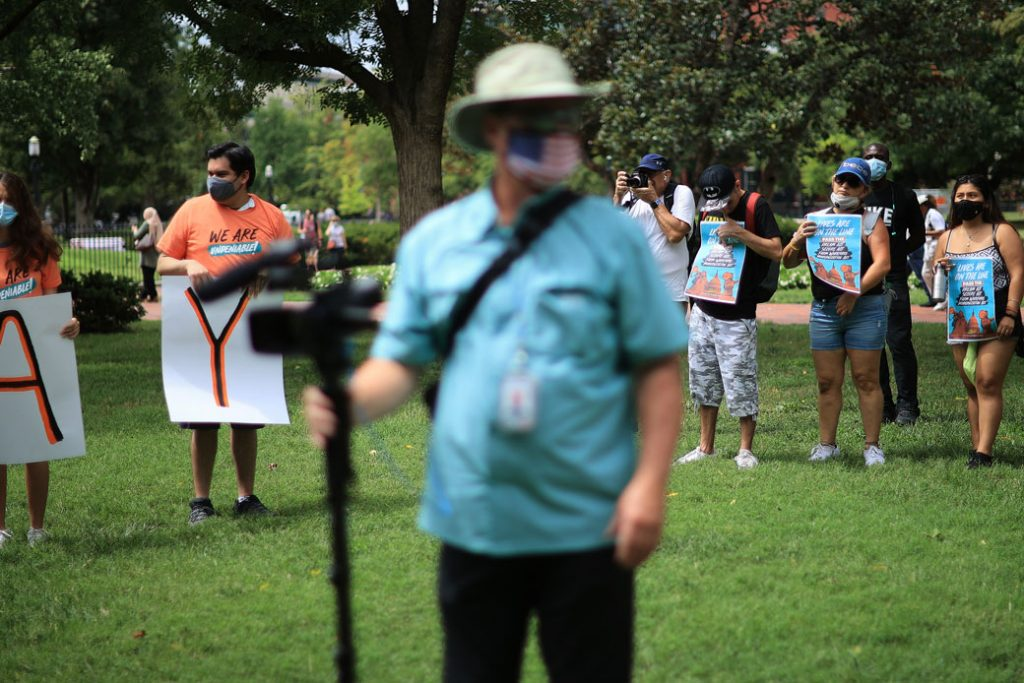 Activists stand in Lafayette Square, across from the White House, in an effort to urge Congress and the Biden administration to create a pathway to citizenship for millions of immigrants on August 17, 2021, in Washington, D.C.