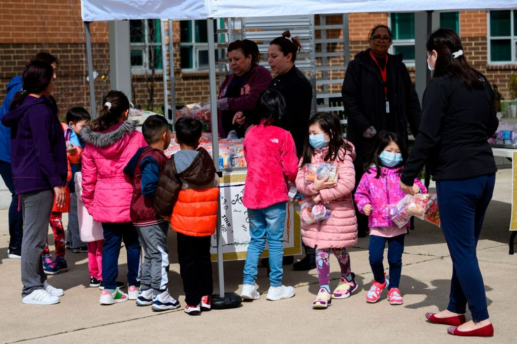 Children pick up free lunch at a middle school in Arlington, Virginia, March 2020.