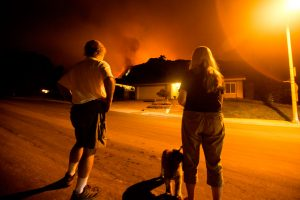 People watch as the Bobcat Fire burns land in Monrovia, California, on September 15, 2020. Credit: Getty Images/Ringo Chiu