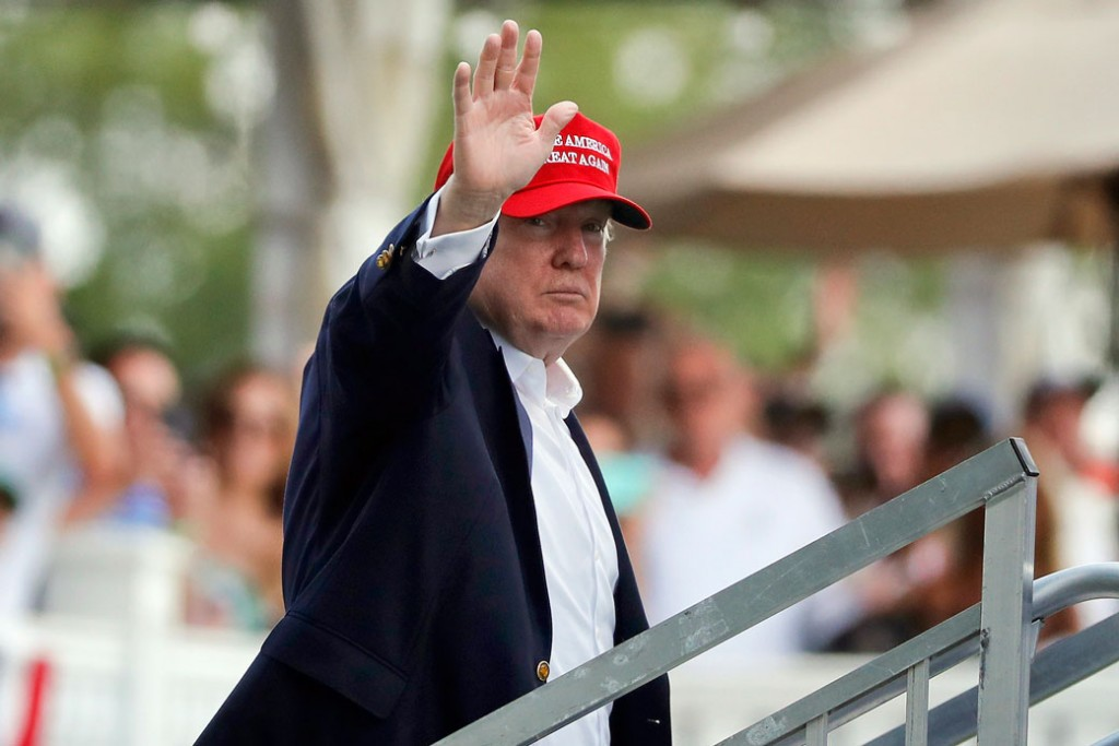 President Donald Trump waves to spectators at the Trump National Golf Club in Bedminster, New Jersey, on July 15, 2017.