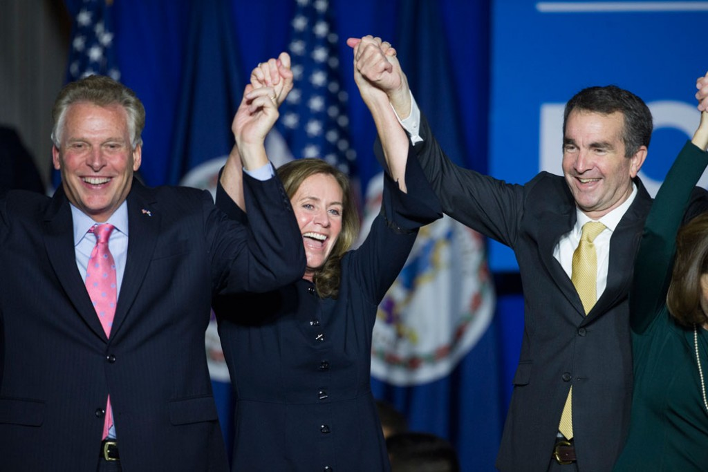 CAPTION: Virginia Gov.-elect Ralph Northam (D) celebrates his election victory with Virginia Gov. Terry McAuliffe and his wife Dorothy.