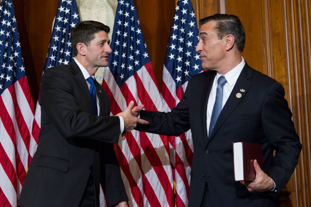 House Speaker Paul Ryan (R-WI) shakes hands with Rep. Darrell Issa (R-CA), on January 3, 2017, on Capitol Hill.