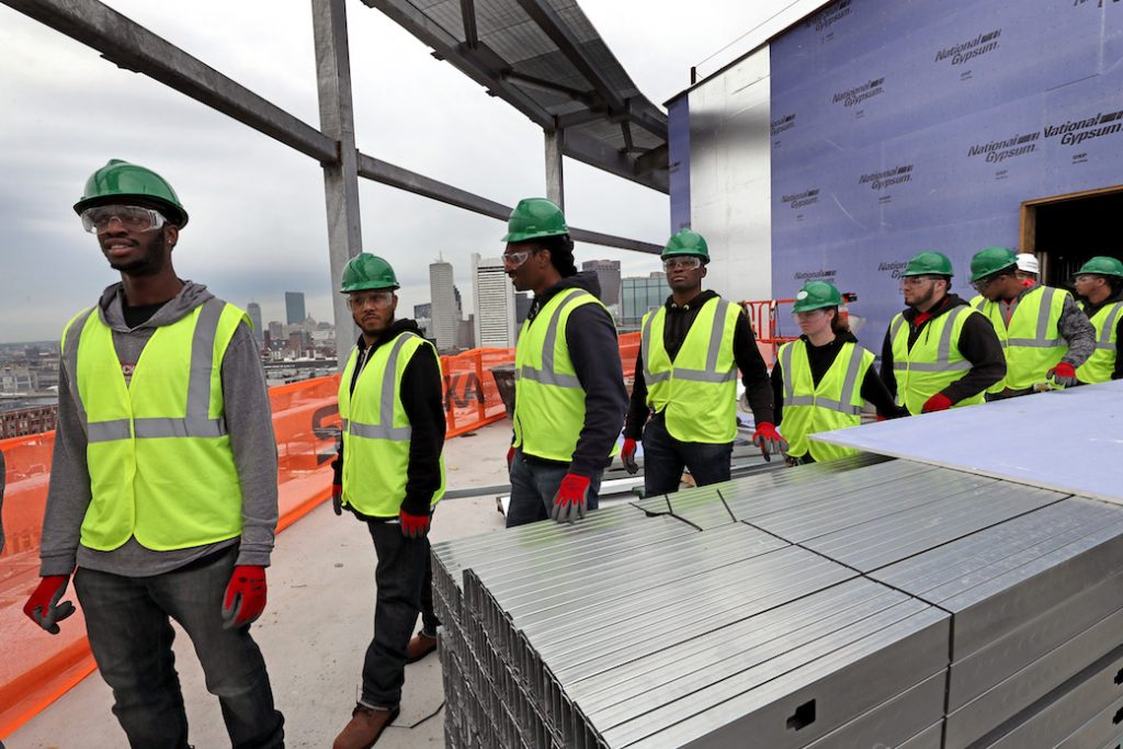 BOSTON, MA - MAY 24: Building Pathways, an organization that creates opportunities for low-income area residents to access and prepare for building trades in the construction industry, tours Skanskas 121 Seaport construction site in Boston on May 24, 2017. The program is 6 weeks and many of them will graduate and pursue union jobs. The day's class had about 10 students ages 19  57. (Photo by David L. Ryan/The Boston Globe via Getty Images)