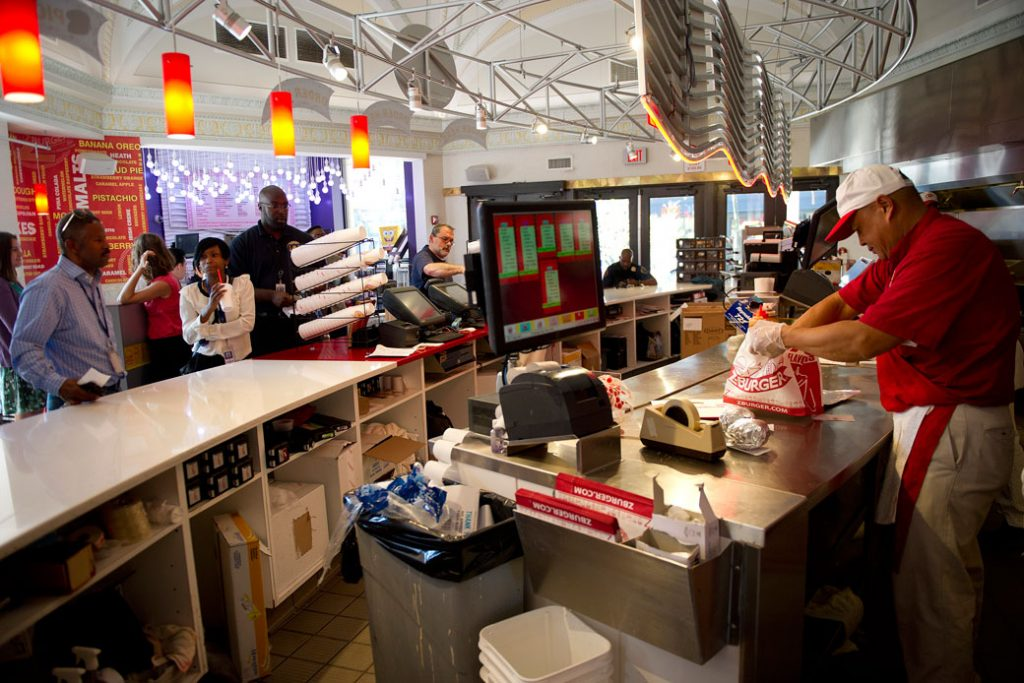 A fast-food employee works at a chain restaurant in Washington, D.C., on October 1, 2013.
