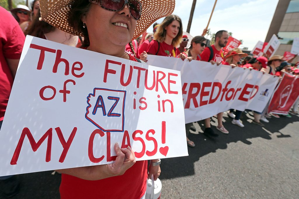 Arizona teachers march toward the state Capitol as part of a rally for the #REDforED movement on April 26, 2018, in Phoenix.