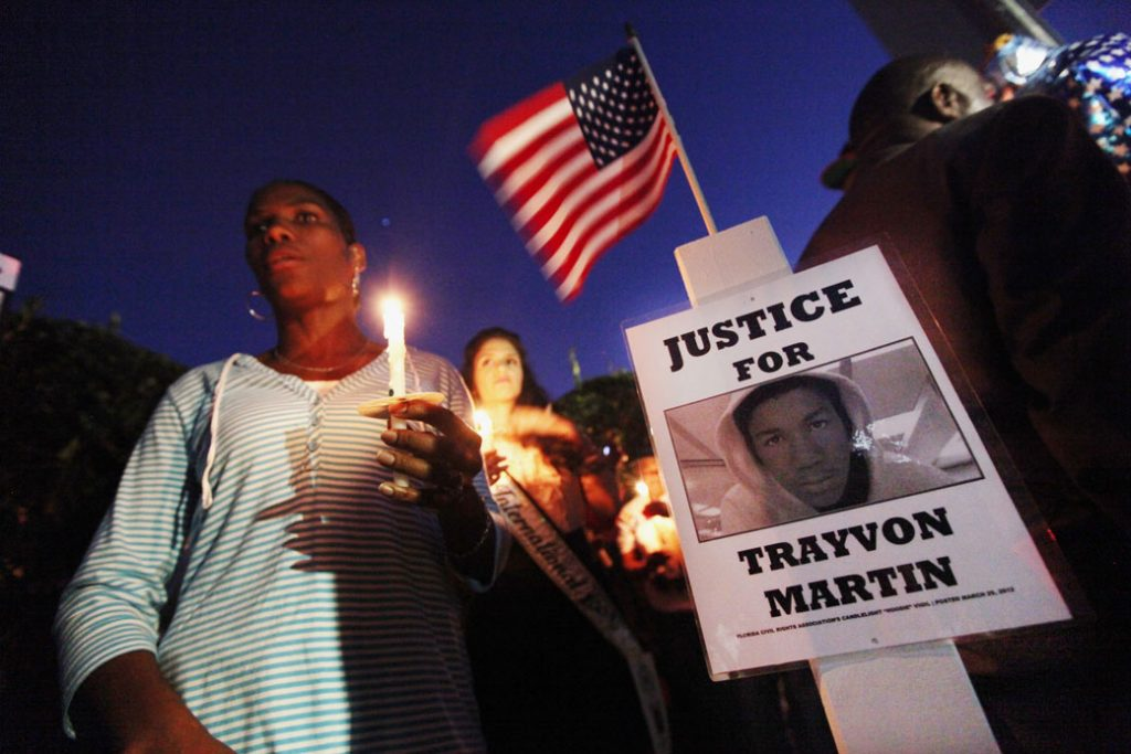 Supporters gather during a candlelight vigil at a memorial for Trayvon Martin in Sanford, Florida, March 2012.