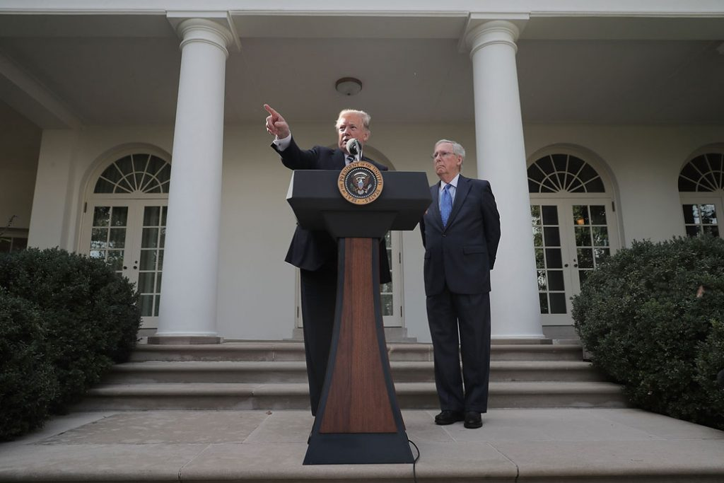 President Donald Trump and Senate Majority Leader Mitch McConnell (R-KY) talk to reporters in the Rose Garden at the White House, October 2017.