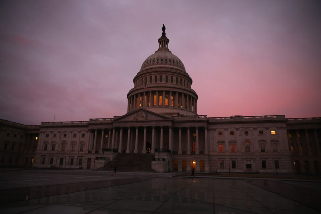 The morning sun rises behind the U.S. Capitol in Washington, D.C., March 2014.